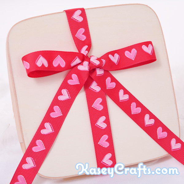 GG21_patterned_ribbon_grosgrain_red_with_pink_hearts_5_8_16mm